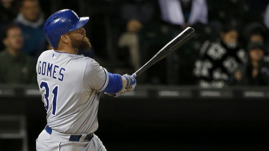 RETRANSMISSION TO CORRECT NAME OF PLAYER SCORING TO SALVADOR PEREZ FROM CHESLOR CUTHBERT - Kansas City Royals' Jonny Gomes watches his sacrifice fly off Chicago White Sox starting pitcher John Danks, scoring pinch runner Salvador Perez, during the fifth inning of a baseball game Thursday, Oct. 1, 2015, in Chicago. (AP Photo/Charles Rex Arbogast)