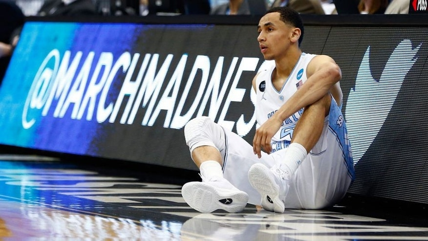 JACKSONVILLE, FL - MARCH 21: Marcus Paige #5 of the North Carolina Tar Heels looks on against the Arkansas Razorbacks in the first half during the third round of the 2015 NCAA Men's Basketball Tournament at Jacksonville Veterans Memorial Arena on March 21, 2015 in Jacksonville, Florida. (Photo by Kevin C. Cox/Getty Images)