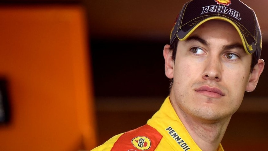 MARTINSVILLE, VA - OCTOBER 31: Joey Logano, driver of the #22 Shell Pennzoil Ford, stands in the garage area during practice for the NASCAR Sprint Cup Series Goody's Headache Relief Shot 500 at Martinsville Speedway on October 31, 2015 in Martinsville, Virginia. (Photo by Jonathan Moore/Getty Images)