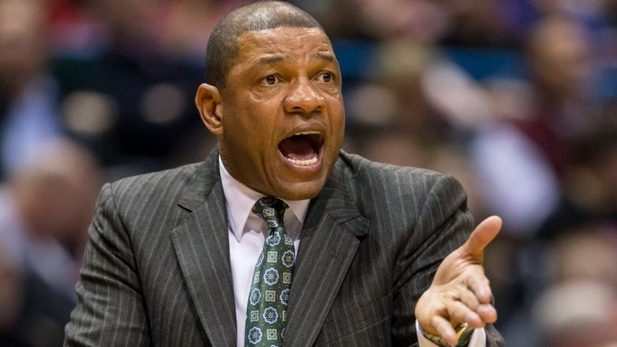 <p>Jan 27, 2014; Milwaukee, WI, USA; Los Angeles Clippers head coach Doc Rivers calls out during the second quarter against the Milwaukee Bucks at BMO Harris Bradley Center. Mandatory Credit: Jeff Hanisch-USA TODAY Sports</p>