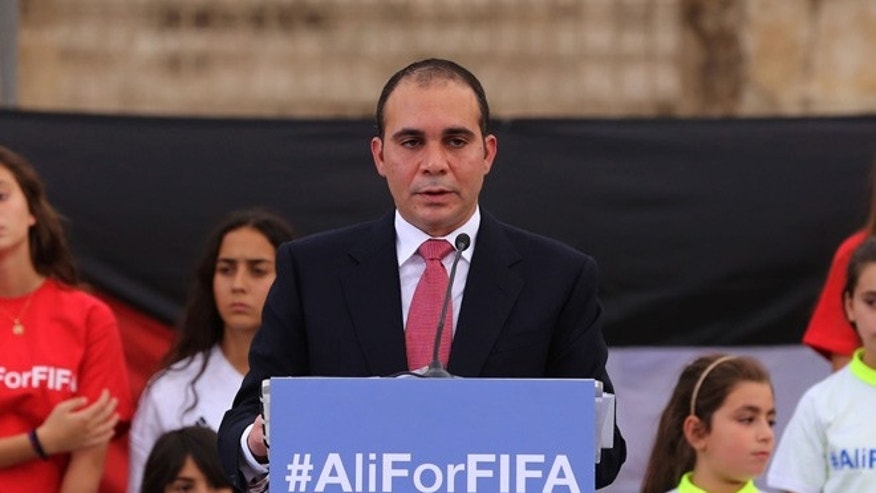 "FILE- In this file photo dated Wednesday, Sept. 9, 2015, Jordan's Prince Ali bin al-Hussein, flanked by school-age soccer players, speaks to about 300 guests during an event at a Roman amphitheater in Amman, Jordan. Seven men are in the running to replace Sepp Blatter as FIFA president, with Michel Platini's candidature accepted but pending because of his suspension from soccer. FIFA published the list of valid applications ""proposed in due time and form"" on Wednesday Oct. 28, 2015. It did not include former Trinidad and Tobago player David Nakhid, who did not have the five required nominations. he seven candidates for the Feb. 26 election are: Platini, Prince Ali bin al-Hussein, Gianni Infantino, Tokyo Sexwale, Musa Bility, Jerome Champagne and Sheikh Salman bin Ebrahim Al Khalifa.  (AP Photo/Raad Adayleh, FILE)"