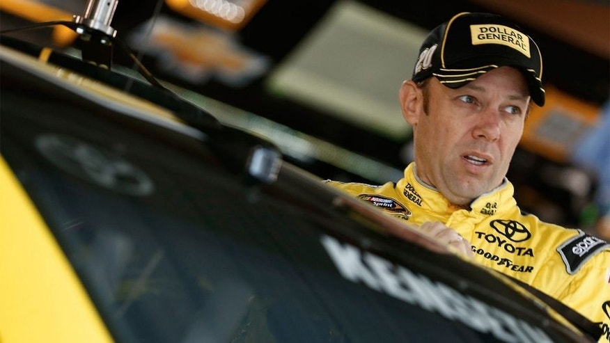MARTINSVILLE, VA - OCTOBER 31: Matt Kenseth, driver of the #20 Dollar General Toyota, climbs into his car during practice for the NASCAR Sprint Cup Series Goody's Headache Relief Shot 500 at Martinsville Speedway on October 31, 2015 in Martinsville, Virginia. (Photo by Jeff Zelevansky/Getty Images)
