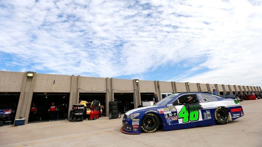 FORT WORTH, TX - NOVEMBER 06: Michael Annett, driver of the #46 Pilot Flying J Chevrolet, drives through the garage area during practice for the NASCAR Sprint Cup Series AAA Texas 500 at Texas Motor Speedway on November 6, 2015 in Fort Worth, Texas. (Photo by Matt Sullivan/NASCAR via Getty Images)