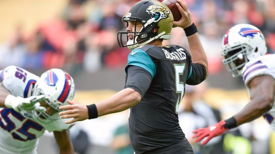 Oct 25, 2015; London, United Kingdom; Jacksonville Jaguars quarterback Blake Bortles (5) runs as he looks for a pass down field during the first half of the game Jacksonville Jaguars and the Buffalo Bills at Wembley Stadium. Mandatory Credit: Steve Flynn-USA TODAY Sports
