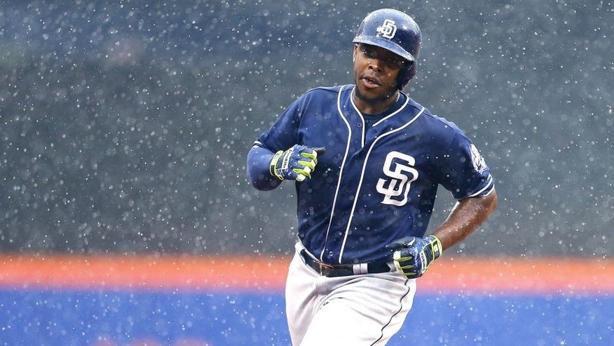 NEW YORK, NY - JULY 30: Justin Upton #10 of the San Diego Padres rounds the bases after hitting a three run home run in the ninth inning against the New York Mets at Citi Field on July 30, 2015 in Flushing neighborhood of the Queens borough of New York City. (Photo by Mike Stobe/Getty Images)