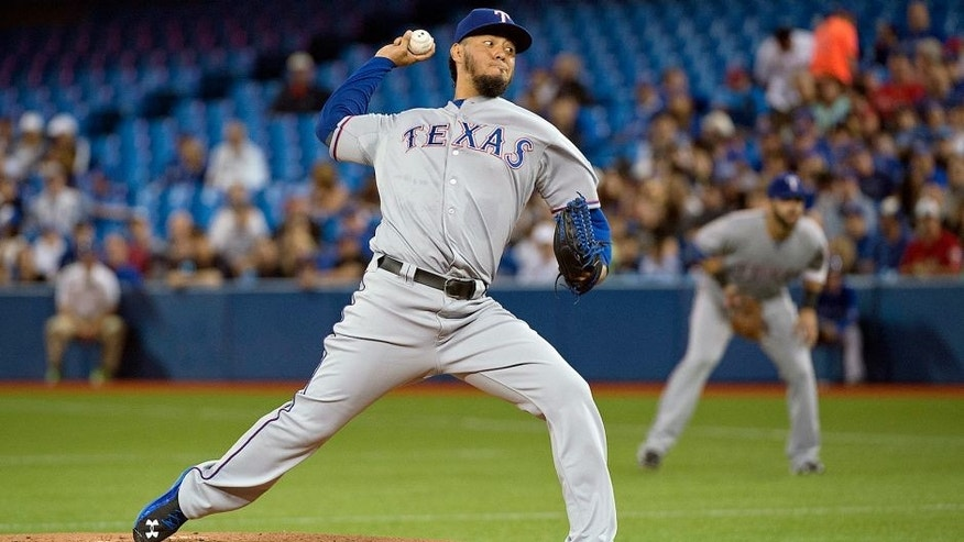 Jun 27, 2015; Toronto, Ontario, CAN; Texas Rangers starting pitcher Yovani Gallardo (49) throws a pitch during the first inning in a game against the Toronto Blue Jays at Rogers Centre. Mandatory Credit: Nick Turchiaro-USA TODAY Sports