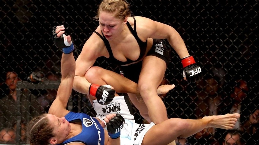 ANAHEIM, CA - FEBRUARY 23: Ronda Rousey hits Liz Carmouche during their UFC Bantamweight Title fight at Honda Center on February 23, 2013 in Anaheim, California. (Photo by Jeff Gross/Getty Images)