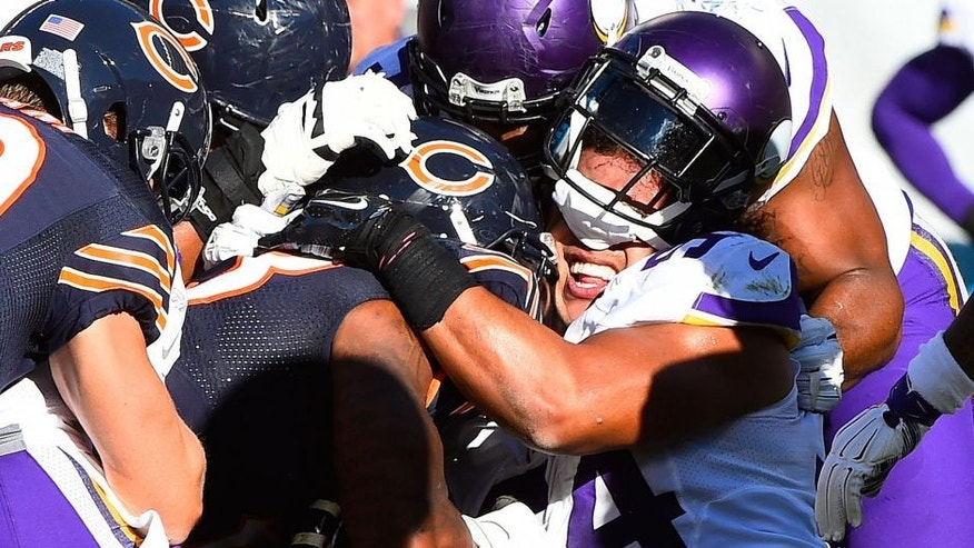 Nov 1, 2015; Chicago, IL, USA; Minnesota Vikings middle linebacker Eric Kendricks (54) has his helmet knocked off by Chicago Bears running back Jeremy Langford (33) during the second half at Soldier Field. Mandatory Credit: Mike DiNovo-USA TODAY Sports