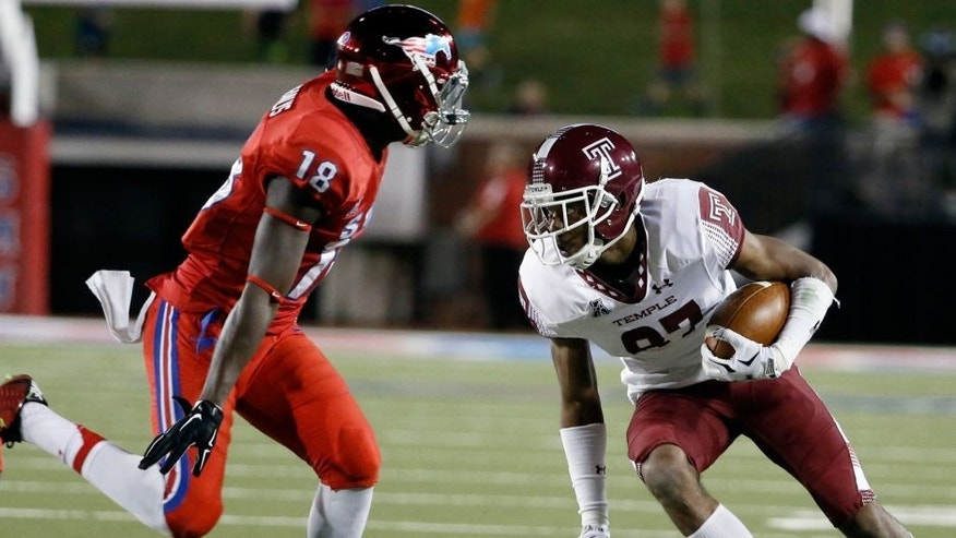 SMU defensive back William Jeanlys (18) attempts to stop Temple wide receiver Ventell Bryant (87) as Bryant gains yardage after making a catch in the first half of an NCAA college football game Friday, Nov. 6, 2015, in Dallas. (AP Photo/Tony Gutierrez)