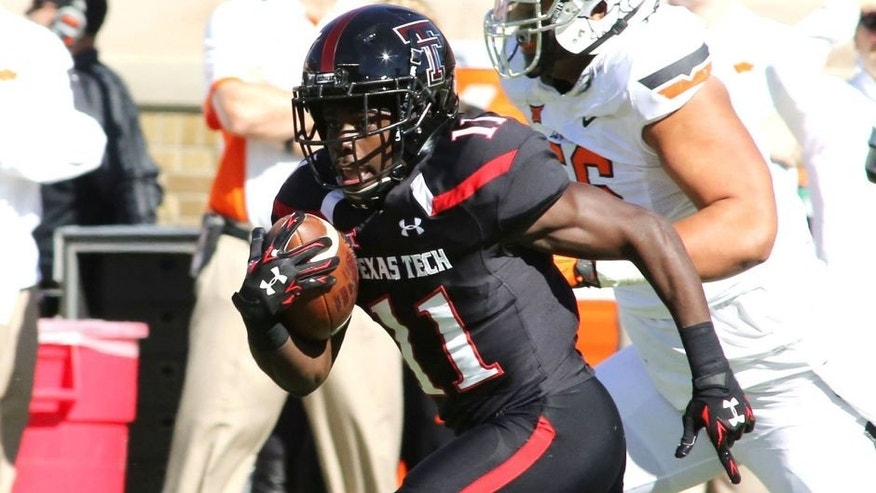 Oct 31, 2015; Lubbock, TX, USA; Texas Tech Red Raiders running back Jakeem Grant (11) returns a kickoff for a touchdown against the Oklahoma State Cowboys in the first half at Jones AT&T Stadium. Mandatory Credit: Michael C. Johnson-USA TODAY Sports