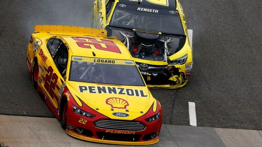 MARTINSVILLE, VA - NOVEMBER 01: Matt Kenseth, driver of the #20 Dollar General Toyota, makes contact with Joey Logano, driver of the #22 Shell Pennzoil Ford, during the NASCAR Sprint Cup Series Goody's Headache Relief Shot 500 at Martinsville Speedway on November 1, 2015 in Martinsville, Virginia. (Photo by Jeff Zelevansky/Getty Images)