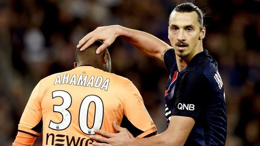 Paris Saint-Germain's Swedish forward Zlatan Ibrahimovic (R) touches the head of Toulouse's French Comorian goalkeeper Ali Ahamada during the French L1 football match Paris Saint-Germain (PSG) vs Toulouse on November 7, 2015 at the Parc des Princes stadium in Paris. AFP PHOTO / FRANCK FIFE (Photo credit should read FRANCK FIFE/AFP/Getty Images)