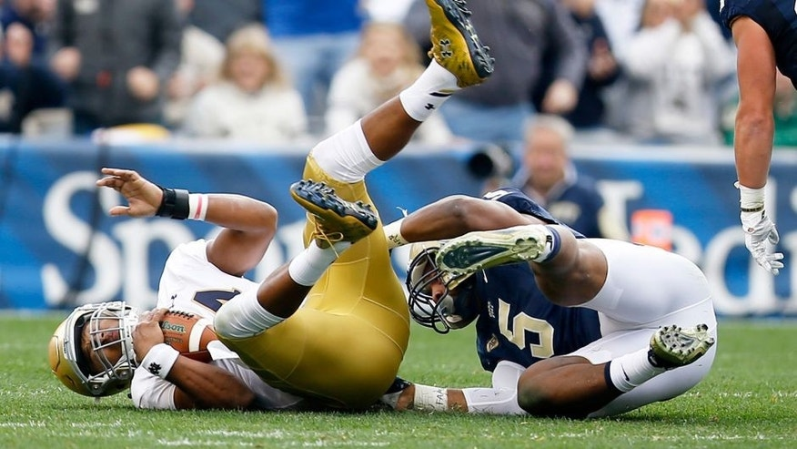 Notre Dame quarterback DeShone Kizer, left, is sacked by Pittsburgh defensive lineman Ejuan Price (5) in the first quarter of an NCAA football game, Saturday, Nov. 7, 2015, in Pittsburgh. (AP Photo/Keith Srakocic)