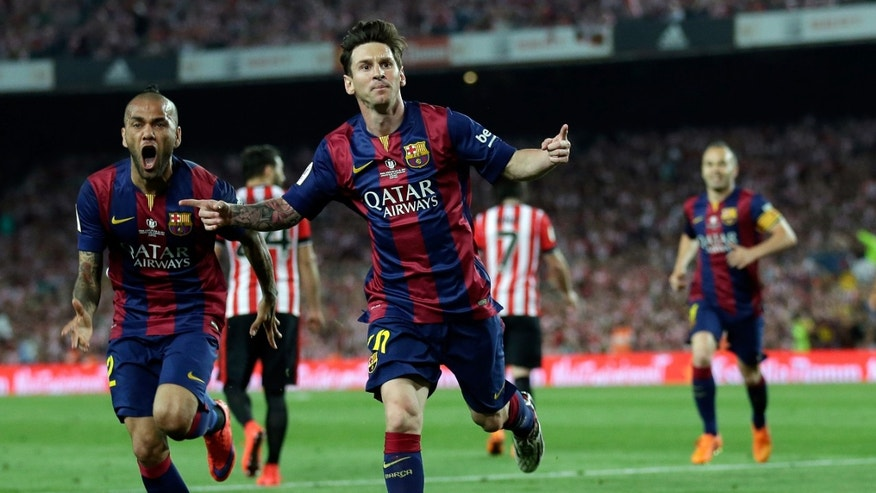 FILE - In this Saturday, May 30, 2015 file photo, Barcelona's Lionel Messi, centre,  celebrates after scoring the opening goal during the final of the Copa del Rey soccer match between FC Barcelona and Athletic Bilbao at the Camp Nou stadium in Barcelona, Spain. Carli Lloyd and Lionel Messi are among the nominees for the FIFA Puskas Award for goal of the year. Lloyd scored for the United States from 50 yards against Japan in the Womenâs World Cup final. Messi beat four defenders before scoring Barcelonaâs first goal against Athletic Bilbao in the Copa del Rey final. (AP Photo/Manu Fernandez, File)