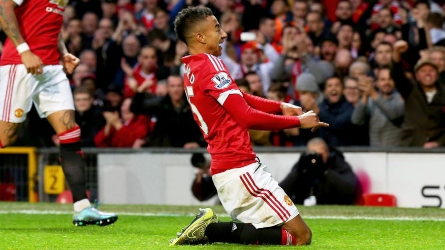 MANCHESTER, ENGLAND - NOVEMBER 07: Jesse Lingard of Manchester United celebrates scoring his team's first goal during the Barclays Premier League match between Manchester United and West Bromwich Albion at Old Trafford on November 7, 2015 in Manchester, England. (Photo by Alex Livesey/Getty Images)