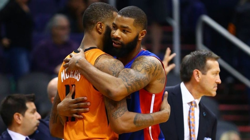 Nov 6, 2015; Phoenix, AZ, USA; Detroit Pistons forward Marcus Morris (right) hugs identical twin brother Phoenix Suns forward Markieff Morris following the game at Talking Stick Resort Arena. The Pistons defeated the Suns 100-92. Mandatory Credit: Mark J. Rebilas-USA TODAY Sports