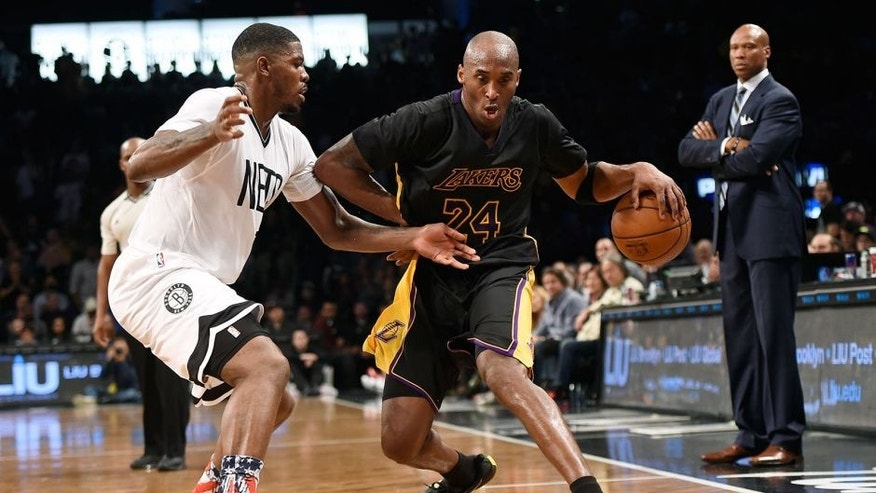 Nov 6, 2015; Brooklyn, NY, USA; Los Angeles Lakers forward Kobe Bryant (24) shoots over Brooklyn Nets forward Joe Johnson (7) and Brooklyn Nets forward Thomas Robinson (41) during first half at Barclays Center. Mandatory Credit: Noah K. Murray-USA TODAY Sports