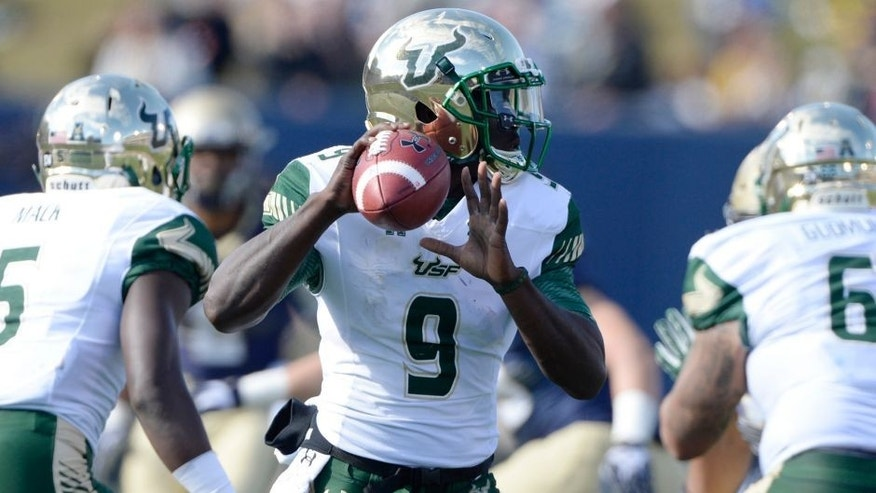 Oct 31, 2015; Annapolis, MD, USA; South Florida Bulls quarterback Quinton Flowers (9) drops back to pass during the third quarter against the South Florida Bulls at Navy Marine Corps Memorial Stadium. Navy defeated South Florida 29-17. Mandatory Credit: Tommy Gilligan-USA TODAY Sports