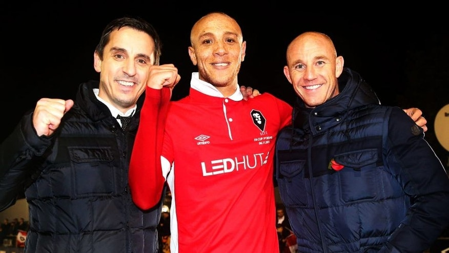 SALFORD, ENGLAND - NOVEMBER 06: Joint Salford City owners Gary Neville (L) and Nicky Butt (R) celebrate victory with goalscorer Richie Allen of Salford City after the Emirates FA Cup first round match between Salford City and Notts County at Moor Lane on November 6, 2015 in Salford, England. (Photo by Chris Brunskill/Getty Images)