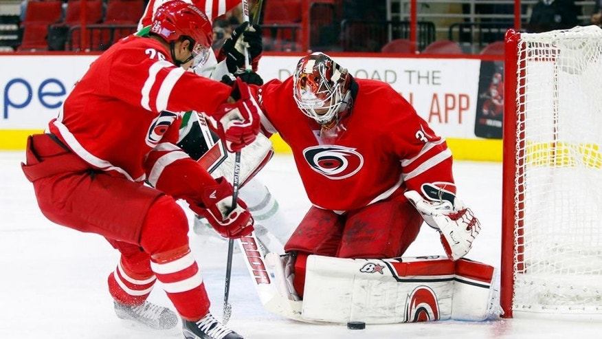 Nov 6, 2015; Raleigh, NC, USA; Carolina Hurricanes goalie Eddie Lack (31) makes 3rd period save against the Dallas Stars at PNC Arena. The Dallas Stars defeated the Carolina Hurricanes 4-1. Mandatory Credit: James Guillory-USA TODAY Sports