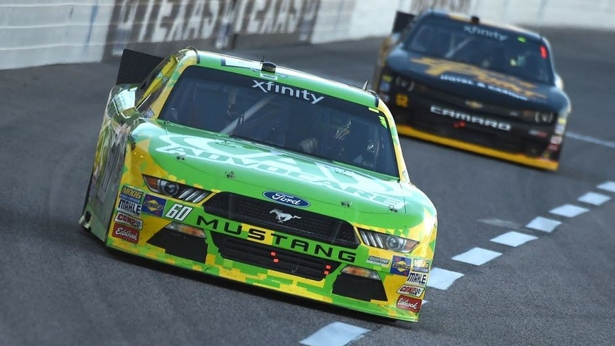 FORT WORTH, TX - NOVEMBER 07: Chris Buescher, driver of the #60 AdvoCare Ford, leads Brendan Gaughan, driver of the #62 South Point Chevrolet, during the NASCAR XFINITY Series O'Reilly Auto Parts Challenge at Texas Motor Speedway on November 7, 2015 in Fort Worth, Texas. (Photo by Rainier Ehrhardt/NASCAR via Getty Images)