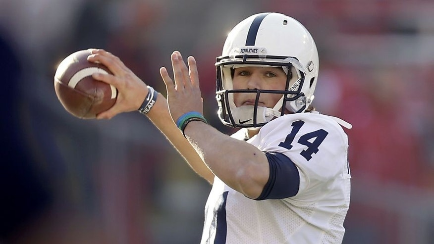 MADISON, WI - NOVEMBER 30: Christian Hackenberg #14 of the Penn State Nittany Lions runs through some pre game drills before the game against the Wisconsin Badgers at Camp Randall Stadium on November 30, 2013 in Madison, Wisconsin. (Photo by Mike McGinnis/Getty Images)