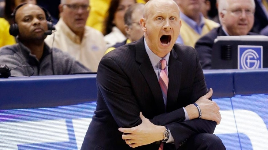 <p>Xavier head coach Chris Mack yells during the first half of an NCAA college basketball game against the Marquette Tuesday, Feb. 10, 2015, in Milwaukee. (AP Photo/Morry Gash)</p>