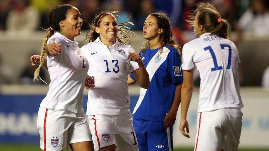 Oct 17, 2014; Bridgeview, IL, USA; USA player Tobin Heath (17) celebrates with teammates Alex Morgan (1) and Sydney Leroux (2) after scoring a goal against Guatemala during a women's World Cup qualifier soccer match at Toyota Park. Mandatory Credit: Jerry Lai-USA TODAY Sports