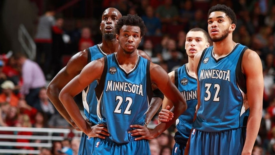 CHICAGO, IL - NOVEMBER 7: Andrew Wiggins #22 of the Minnesota Timberwolves, Kevin Garnett #21 of the Minnesota Timberwolves, Karl-Anthony Towns #32 of the Minnesota Timberwolves and Zach LaVine #8 of the Minnesota Timberwolves stand on the court during the game against the Chicago Bulls on November 7, 2015 at the United Center in Chicago, Illinois. NOTE TO USER: User expressly acknowledges and agrees that, by downloading and or using this Photograph, user is consenting to the terms and conditions of the Getty Images License Agreement. Mandatory Copyright Notice: Copyright 2015 NBAE (Photo by Jeff Haynes/NBAE via Getty Images)