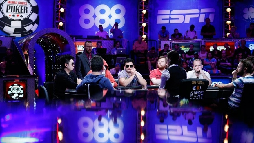 FILE - In this July 14, 2015, file photo, players compete at the World Series of Poker main event in Las Vegas. The World Series of Poker's main event returns Sunday, Nov. 8, offering a $7.6 million prize to the victor. (AP Photo/John Locher, File)