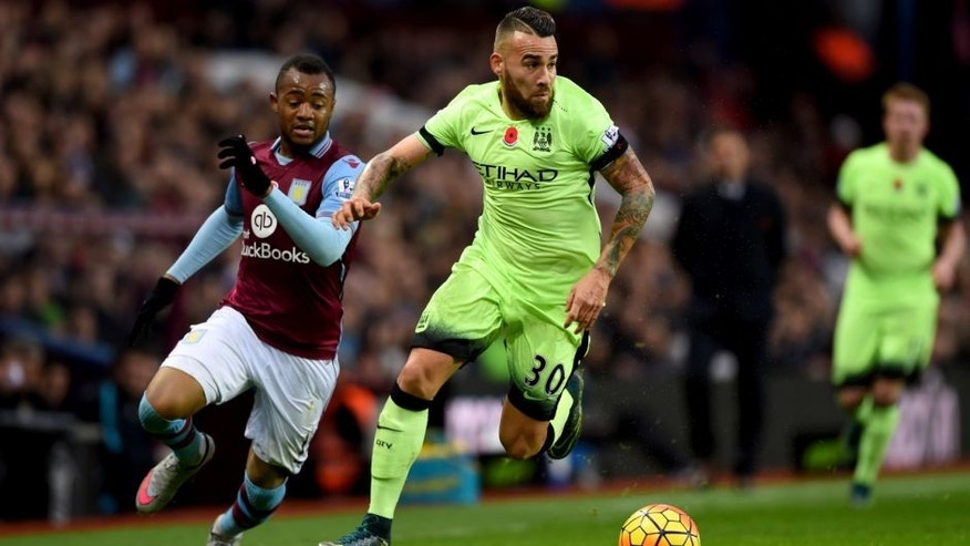 BIRMINGHAM, ENGLAND - NOVEMBER 08: Nicolas Otamendi of Manchester City holds off Jordan Ayew of Aston Villa during the Barclays Premier League match between Aston Villa and Manchester City at Villa Park on November 8, 2015 in Birmingham, England. (Photo by Shaun Botterill/Getty Images)