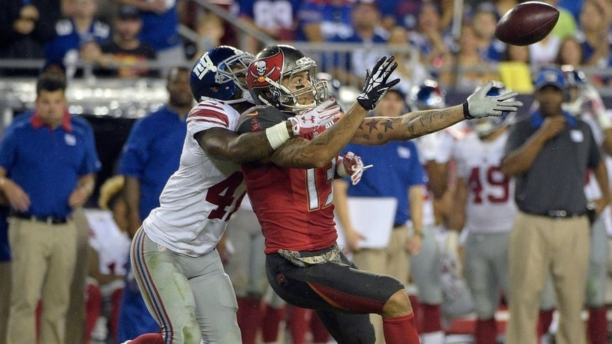 Tampa Bay Buccaneers wide receiver Mike Evans (13) can't reach as pass from quarterback Jameis Winston as he is tied up by New York Giants cornerback Dominique Rodgers-Cromartie (41) during the fourth quarter of an NFL football game Sunday, Nov. 8, 2015, in Tampa, Fla. (AP Photo/Phelan M. Ebenhack)