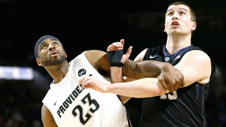 Mar 7, 2015; Providence, RI, USA; Providence Friars forward LaDontae Henton (23) blocks out against Butler Bulldogs forward Andrew Chrabascz (45) during the second half at Dunkin Donuts Center. Mandatory Credit: Mark L. Baer-USA TODAY Sports