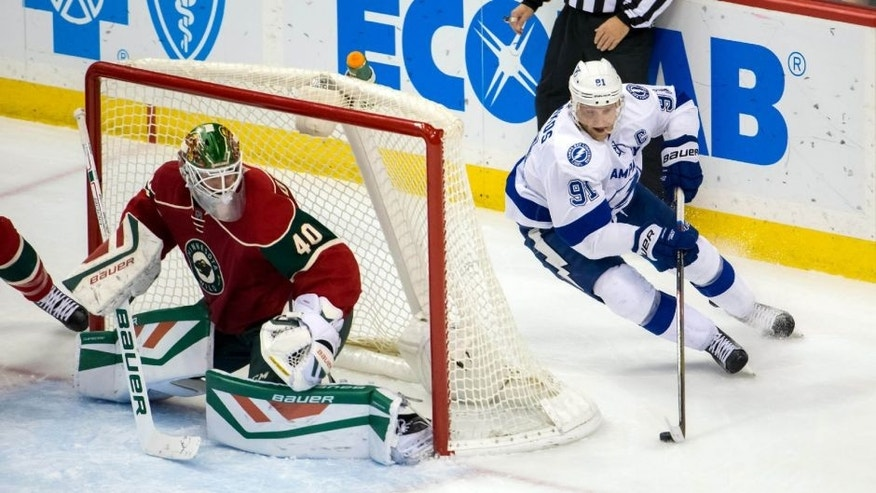 <p>Nov 7, 2015; Saint Paul, MN, USA; Tampa Bay Lightning forward Steven Stamkos (91) attempts a wrap around goal in the second period against the Minnesota Wild goalie Devan Dubnyk (40) at Xcel Energy Center. Mandatory Credit: Brad Rempel-USA TODAY Sports</p>