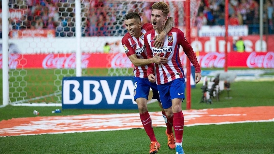 MADRID, SPAIN - NOVEMBER 08: Antoine Griezmann (R) of Atletico de Madrid celebrates scoring their opening goal with teammate Angel Martin Correa (L) during the La Liga mathc bewteen Club Atletico de Madrid and Real Sporting de Gijon at Vicente Calderon Stadium on November 8, 2015 in Madrid, Spain. (Photo by Gonzalo Arroyo Moreno/Getty Images)