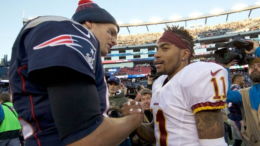 Nov 8, 2015; Foxborough, MA, USA; New England Patriots quarterback Tom Brady (12) greets Washington Redskins wide receiver DeSean Jackson (11) after the game at Gillette Stadium. The Patriots defeated the Redskins 27-10. Mandatory Credit: David Butler II-USA TODAY Sports