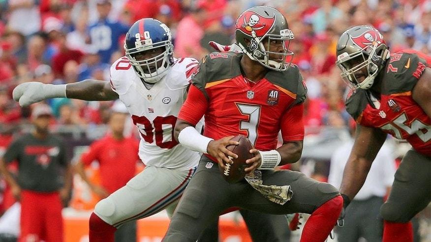 TAMPA, FL - NOVEMBER 08: Jameis Winston #3 of the Tampa Bay Buccaneers scrambles away from Jason Pierre-Paul #90 of the New York Giants during a game at Raymond James Stadium on November 8, 2015 in Tampa, Florida. (Photo by Mike Ehrmann/Getty Images)