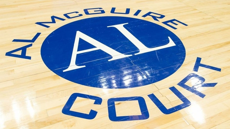 <p>Feb 27, 2014; Milwaukee, WI, USA; The Al McGuire Court logo on the court prior to the game between the Georgetown Hoyas and Marquette Golden Eagles at BMO Harris Bradley Center. Marquette won 75-73. Mandatory Credit: Jeff Hanisch-USA TODAY Sports</p>