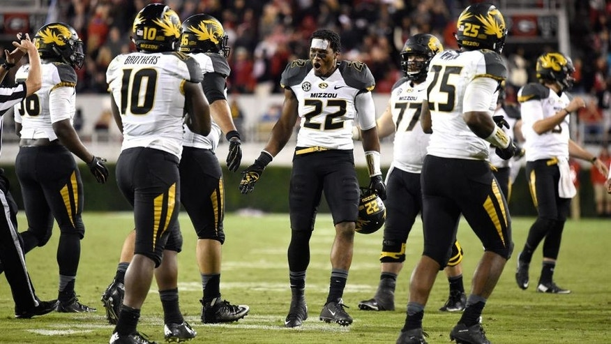 Oct 17, 2015; Athens, GA, USA; Missouri Tigers defensive back Anthony Sherrils (22) and team mates react after the Georgia Bulldogs missed a go ahead field goal during the second half at Sanford Stadium. Georgia defeated Missouri 9-6. Mandatory Credit: Dale Zanine-USA TODAY Sports