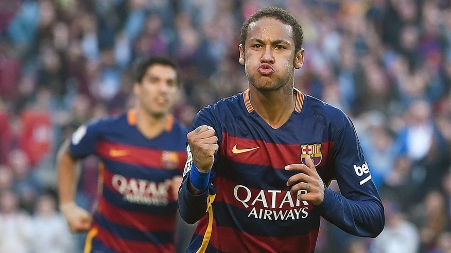 Barcelona's Brazilian forward Neymar da Silva Santos Junior celebrates his goal during the Spanish league football match FC Barcelona vs Villarreal CF at the Camp Nou stadium in Barcelona on November 8, 2015. AFP PHOTO/ JOSEP LAGO (Photo credit should read JOSEP LAGO/AFP/Getty Images)