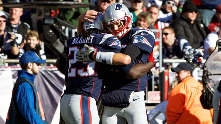 Nov 8, 2015; Foxborough, MA, USA; New England Patriots quarterback Tom Brady (12) congratulates running back LeGarrette Blount (29) after scoring against the Washington Redskins in the first quarter at Gillette Stadium. Mandatory Credit: David Butler II-USA TODAY Sports