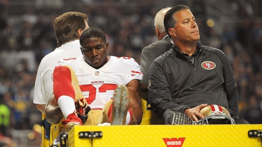 ST. LOUIS, MO - NOVEMBER 1: Reggie Bush #23 of the San Francisco 49ers is carted off the field after being injured in the second quarter against the St. Louis Rams at the Edward Jones Dome on November 1, 2015 in St. Louis, Missouri. (Photo by Michael B. Thomas/Getty Images)