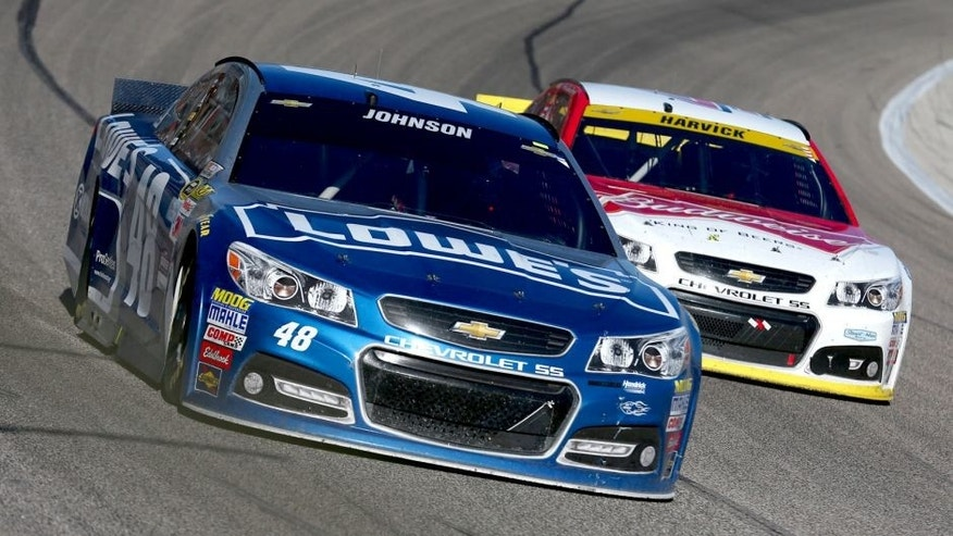 FORT WORTH, TX - NOVEMBER 08: Jimmie Johnson, driver of the #48 Lowe's Chevrolet, leads Kevin Harvick, driver of the #4 Budweiser/Jimmy John's Chevrolet, during the NASCAR Sprint Cup Series AAA Texas 500 at Texas Motor Speedway on November 8, 2015 in Fort Worth, Texas. (Photo by Tom Pennington/Getty Images)