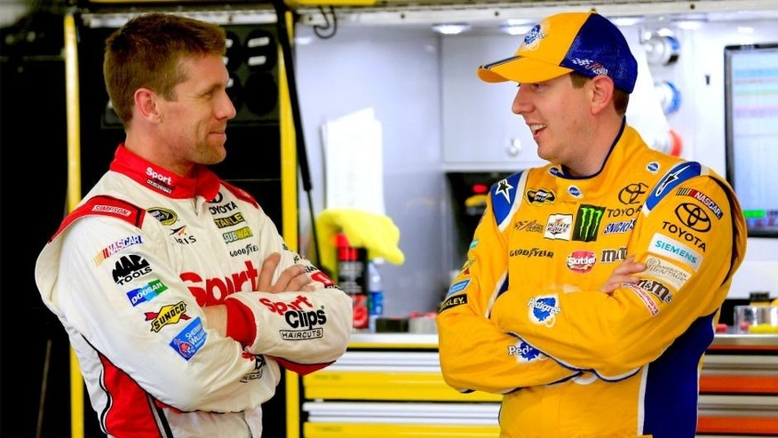 LOUDON, NH - SEPTEMBER 25: Carl Edwards, left, driver of the #19 Sport Clips Toyota, talks with Kyle Busch, driver of the #18 Pedigree Toyota, in the garage area during practice for the NASCAR Sprint Cup Series Sylvania 300 at New Hampshire Motor Speedway on September 25, 2015 in Loudon, New Hampshire. (Photo by Chris Trotman/Getty Images)