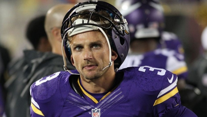<p>FILE - In this Aug. 22, 2015, file photo, Minnesota Vikings kicker Blair Walsh stands in the bench area during the second half of a preseason NFL football game against the Oakland Raiders in Minneapolis. The Vikings gave Blair Walsh a contract extension in the offseason, locking up their Pro Bowl kicker for the long term. But he's been shaky in the preseason, including three missed field goals and a shanked extra point against Oakland. (AP Photo/Andy King, File)</p>