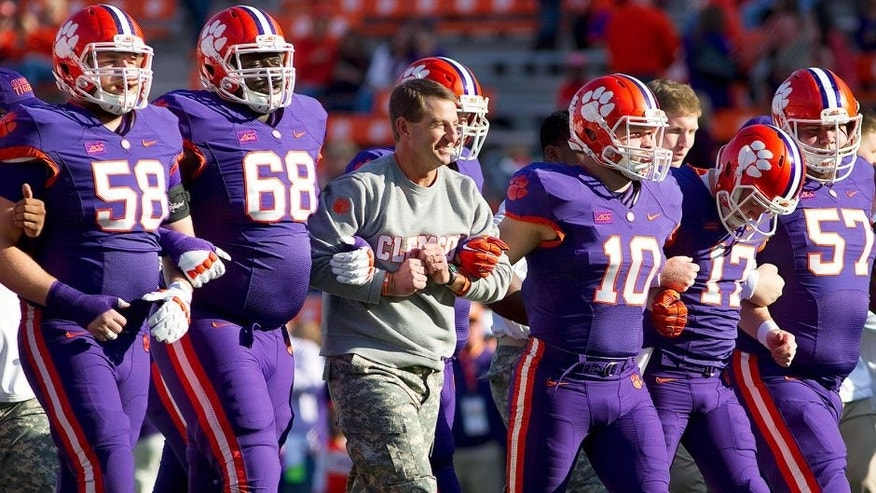 Nov 22, 2014; Clemson, SC, USA; Clemson Tigers head coach Dabo Swinney (center) prior to the game against the Georgia State Panthers at Clemson Memorial Stadium. Mandatory Credit: Joshua S. Kelly-USA TODAY Sports