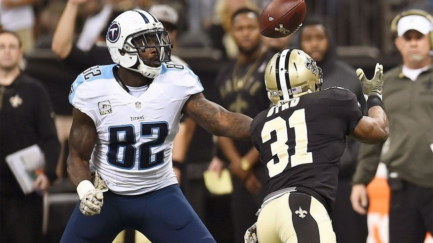 NEW ORLEANS, LA - NOVEMBER 08: Delanie Walker #82 of the Tennessee Titans and Jairus Byrd #31 of the New Orleans Saints reach for a loose ball during the second quarter of a game at the Mercedes-Benz Superdome on November 8, 2015 in New Orleans, Louisiana. (Photo by Stacy Revere/Getty Images)