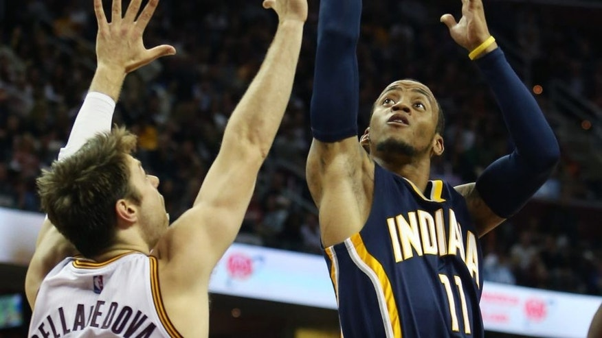 Indiana Pacers guard Monta Ellis (11) shoots over Cleveland Cavaliers guard Matthew Dellavedova (8) during the first half of an NBA basketball game, Sunday, Nov. 8, 2015, in Cleveland. (AP Photo/Ron Schwane)