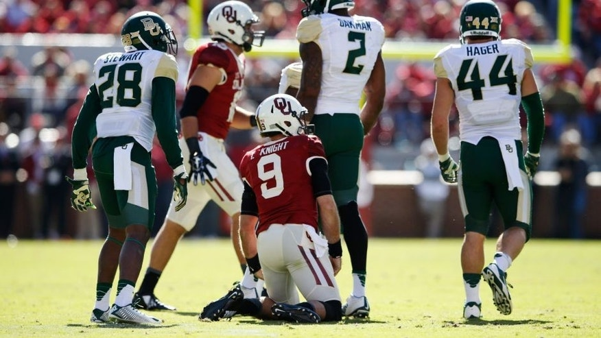 Nov 8, 2014; Norman, OK, USA; Oklahoma Sooners quarterback Trevor Knight (9) during the first half against the Baylor Bears at Gaylord Family - Oklahoma Memorial Stadium. Mandatory Credit: Kevin Jairaj-USA TODAY Sports