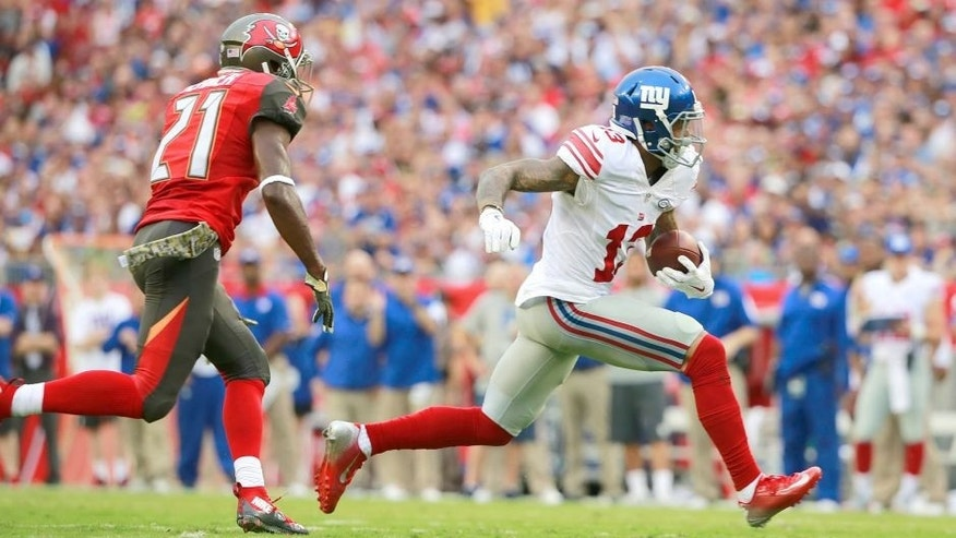 Nov 8, 2015; Tampa, FL, USA; New York Giants wide receiver Odell Beckham (13) runs with the ball as Tampa Bay Buccaneers cornerback Alterraun Verner (21) defends during the first quarter at Raymond James Stadium. Mandatory Credit: Kim Klement-USA TODAY Sports